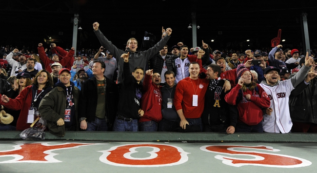 Oct 30, 2013; Boston, MA, USA; Boston Red Sox fans celebrate after game six of the MLB baseball World Series against the St. Louis Cardinals at Fenway Park. The Red Sox won 6-1 to win the series four games to two. Mandatory Credit: Robert Deutsch-USA TODAY Sports