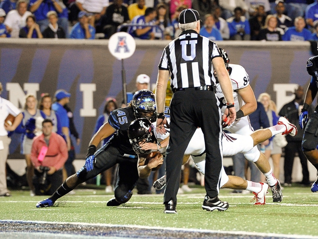 Oct 30, 2013; Memphis, TN, USA; Cincinnati Bearcats fullback Jordan Luallen (10) dives for a touchdown against Memphis Tigers during the second half at Liberty Bowl Memorial. Cincinnati Bearcats defeated the Memphis Tigers 34 to 21 Mandatory Credit: Justin Ford-USA TODAY Sports