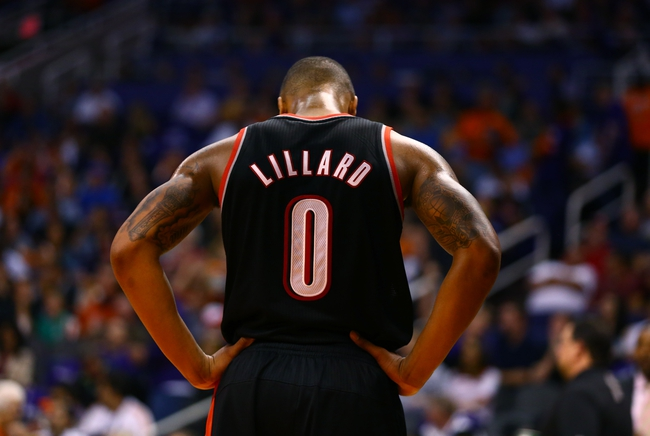 Oct 30, 2013; Phoenix, AZ, USA; Portland Trail Blazers guard Damian Lillard reacts in the fourth quarter against the Phoenix Suns at US Airways Center. The Suns defeated the Blazers 104-91. Mandatory Credit: Mark J. Rebilas-USA TODAY Sports