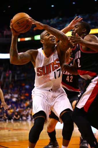 Oct 30, 2013; Phoenix, AZ, USA; Phoenix Suns forward P.J. Tucker drives to the basket in the second half against the Portland Trail Blazers at US Airways Center. The Suns defeated the Blazers 104-91. Mandatory Credit: Mark J. Rebilas-USA TODAY Sports