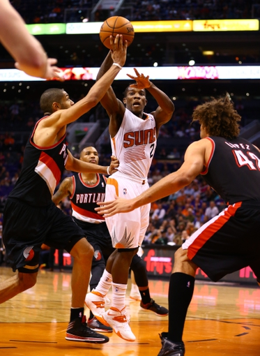 Oct 30, 2013; Phoenix, AZ, USA; Phoenix Suns guard Eric Bledsoe (2) passes the ball in the fourth quarter against the Portland Trail Blazers at US Airways Center. The Suns defeated the Blazers 104-91. Mandatory Credit: Mark J. Rebilas-USA TODAY Sports