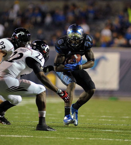 Oct 30, 2013; Memphis, TN, USA; Cincinnati Bearcats safety Zach Edwards (22) tackles Memphis Tigers wide receiver Tevin Jones (87) during the second half at Liberty Bowl Memorial. Cincinnati Bearcats defeated the Memphis Tigers 34 to 21 Mandatory Credit: Justin Ford-USA TODAY Sports