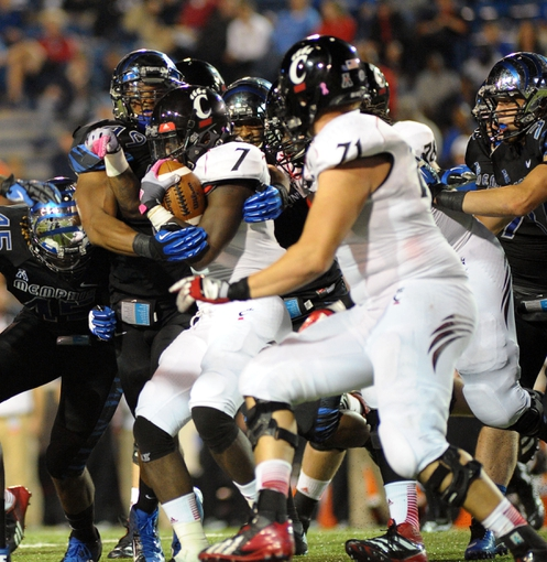 Oct 30, 2013; Memphis, TN, USA; Cincinnati Bearcats running back Tion Green (7) carries the ball against Memphis Tigers during the second half at Liberty Bowl Memorial. Cincinnati Bearcats defeated the Memphis Tigers 34 to 21 Mandatory Credit: Justin Ford-USA TODAY Sports