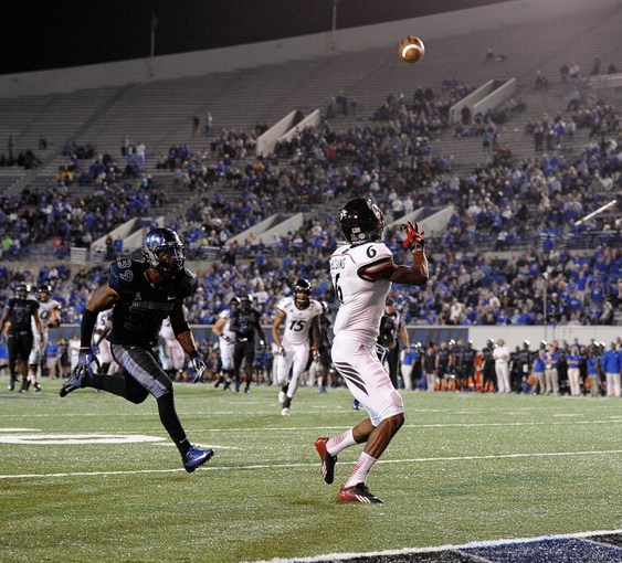 Oct 30, 2013; Memphis, TN, USA; Cincinnati Bearcats wide receiver Anthony McClung (6) catches a pass thrown by Cincinnati Bearcats quarterback Brendon Kay (11) (not pictured) against Memphis Tigers during the second half at Liberty Bowl Memorial. Cincinnati Bearcats defeated the Memphis Tigers 34 to 21 Mandatory Credit: Justin Ford-USA TODAY Sports