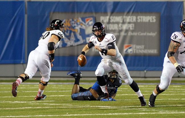 Oct 30, 2013; Memphis, TN, USA; Cincinnati Bearcats quarterback Brendon Kay (11) scrambles against Memphis Tigers during the second half at Liberty Bowl Memorial. Cincinnati Bearcats defeated the Memphis Tigers 34 to 21 Mandatory Credit: Justin Ford-USA TODAY Sports