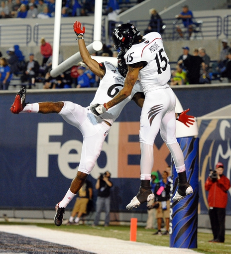 Oct 30, 2013; Memphis, TN, USA; Cincinnati Bearcats wide receiver Anthony McClung (6) and Cincinnati Bearcats wide receiver Chris Moore (15) celebrate after scoring a touchdown against Memphis Tigers during the second half at Liberty Bowl Memorial. Cincinnati Bearcats defeated the Memphis Tigers 34 to 21 Mandatory Credit: Justin Ford-USA TODAY Sports
