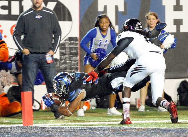 Oct 30, 2013; Memphis, TN, USA; Memphis Tigers running back Brandon Hayes (38) dives for a touchdown against Cincinnati Bearcats during the second half at Liberty Bowl Memorial. Cincinnati Bearcats defeated the Memphis Tigers 34 to 21 Mandatory Credit: Justin Ford-USA TODAY Sports