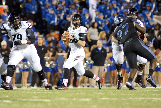 Oct 30, 2013; Memphis, TN, USA; Cincinnati Bearcats quarterback Brendon Kay (11) looks to pass the ball against Memphis Tigers during the second half at Liberty Bowl Memorial. Cincinnati Bearcats defeated the Memphis Tigers 34 to 21 Mandatory Credit: Justin Ford-USA TODAY Sports