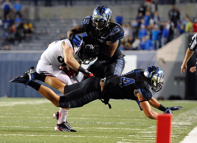 Oct 30, 2013; Memphis, TN, USA; Memphis Tigers linebacker Anthony Brown (45) brings down Cincinnati Bearcats tight end Blake Annen (86) during the second half at Liberty Bowl Memorial. Cincinnati Bearcats defeated the Memphis Tigers 34 to 21 Mandatory Credit: Justin Ford-USA TODAY Sports