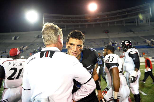 Oct 30, 2013; Memphis, TN, USA; Memphis Tigers quarterback Jacob Karam (9) talks to Cincinnati Bearcats head coach Tommy Tuberville after the game at Liberty Bowl Memorial. Cincinnati Bearcats defeated the Memphis Tigers 34 to 21 Mandatory Credit: Justin Ford-USA TODAY Sports