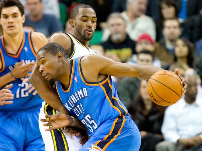 Oct 30, 2013; Salt Lake City, UT, USA; Oklahoma City Thunder small forward Kevin Durant (35) drives toward the basket while defended by Utah Jazz small forward Mike Harris (33) during the second half at EnergySolutions Arena. Oklahoma City won 101-98. Mandatory Credit: Russ Isabella-USA TODAY Sports