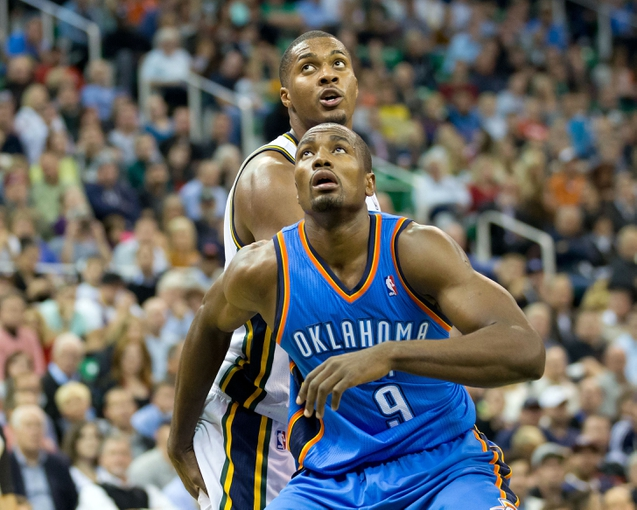 Oct 30, 2013; Salt Lake City, UT, USA; Oklahoma City Thunder power forward Serge Ibaka (9) boxes out Utah Jazz power forward Derrick Favors (15) during the second half at EnergySolutions Arena. Oklahoma City won 101-98. Mandatory Credit: Russ Isabella-USA TODAY Sports