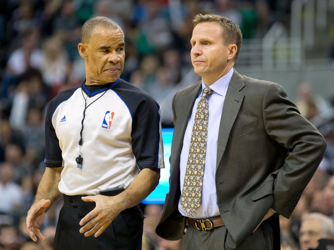 Oct 30, 2013; Salt Lake City, UT, USA; Oklahoma City Thunder head coach Scott Brooks talks with referee Dan Crawford (43) during the second half against the Utah Jazz at EnergySolutions Arena. Oklahoma City won 101-98. Mandatory Credit: Russ Isabella-USA TODAY Sports
