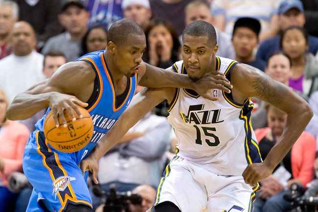 Oct 30, 2013; Salt Lake City, UT, USA; Oklahoma City Thunder power forward Serge Ibaka (9) is defended by Utah Jazz power forward Derrick Favors (15) during the second half at EnergySolutions Arena. Oklahoma City won 101-98. Mandatory Credit: Russ Isabella-USA TODAY Sports