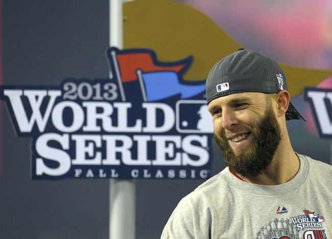 Oct 30, 2013; Boston, MA, USA; Boston Red Sox second baseman Dustin Pedroia after game six of the MLB baseball World Series against the St. Louis Cardinals at Fenway Park. The Red Sox won 6-1 to win the series four games to two. Mandatory Credit: Bob DeChiara-USA TODAY Sports