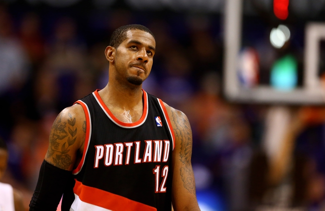 Oct 30, 2013; Phoenix, AZ, USA; Portland Trail Blazers forward LaMarcus Aldridge reacts in the fourth quarter against the Phoenix Suns at US Airways Center. The Suns defeated the Blazers 104-91. Mandatory Credit: Mark J. Rebilas-USA TODAY Sports
