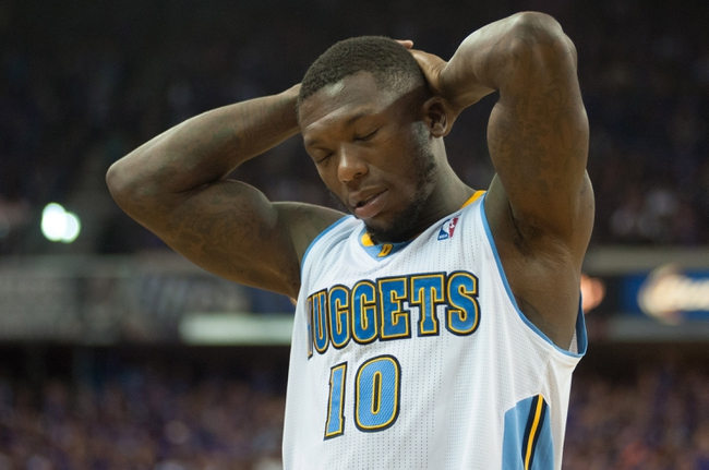 Oct 30, 2013; Sacramento, CA, USA; Denver Nuggets point guard Nate Robinson (10) reacts after the Sacramento Kings scored during the fourth quarter at Sleep Train Arena. The Sacramento Kings defeated the Denver Nuggets 90-88. Mandatory Credit: Ed Szczepanski-USA TODAY Sports