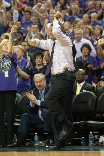 Oct 30, 2013; Sacramento, CA, USA; Sacramento mayor Kevin Johnson jumps in excitement after the Sacramento Kings scored on the Denver Nuggets during the fourth quarter at Sleep Train Arena. The Sacramento Kings defeated the Denver Nuggets 90-88. Mandatory Credit: Ed Szczepanski-USA TODAY Sports