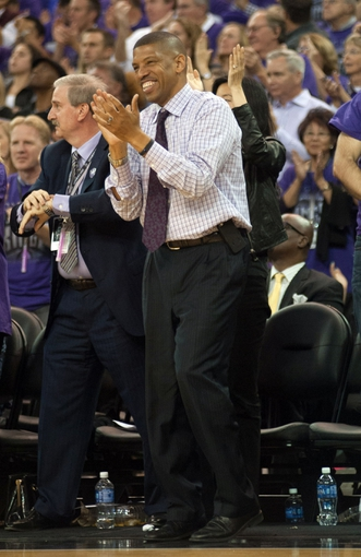 Oct 30, 2013; Sacramento, CA, USA; Sacramento mayor Kevin Johnson celebrates after the Sacramento Kings scored on the Denver Nuggets during the fourth quarter at Sleep Train Arena. The Sacramento Kings defeated the Denver Nuggets 90-88. Mandatory Credit: Ed Szczepanski-USA TODAY Sports