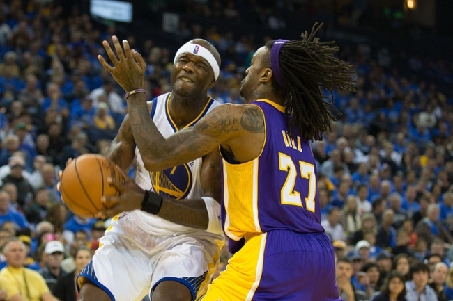 Oct 30, 2013; Oakland, CA, USA; Golden State Warriors center Jermaine O'Neal (7) drives in against Los Angeles Lakers center Jordan Hill (27) during the fourth quarter at Oracle Arena. The Golden State Warriors defeated the Los Angeles Lakers 125-94. Mandatory Credit: Kelley L Cox-USA TODAY Sports