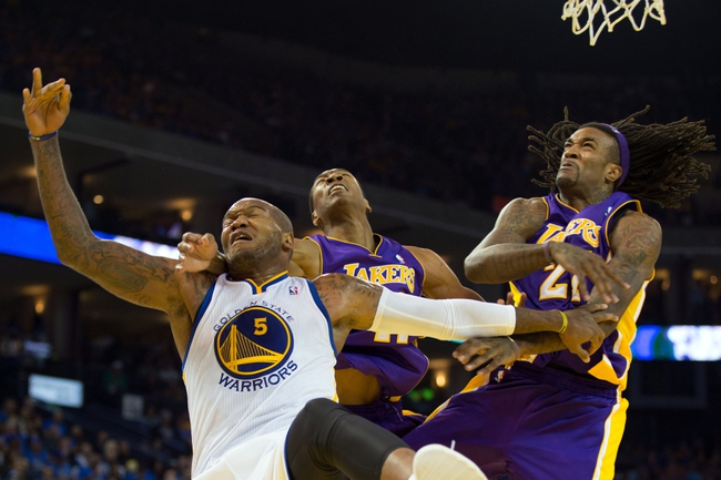 Oct 30, 2013; Oakland, CA, USA; Los Angeles Lakers center Jordan Hill (27) fouls Golden State Warriors power forward Marreese Speights (5) with Los Angeles Lakers shooting guard Wesley Johnson (11) during the fourth quarter at Oracle Arena. The Golden State Warriors defeated the Los Angeles Lakers 125-94. Mandatory Credit: Kelley L Cox-USA TODAY Sports