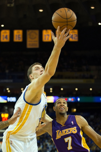 Oct 30, 2013; Oakland, CA, USA; Los Angeles Lakers point guard Jordan Farmar (1) extends for the ball above Los Angeles Lakers shooting guard Xavier Henry (7) during the fourth quarter at Oracle Arena. The Golden State Warriors defeated the Los Angeles Lakers 125-94. Mandatory Credit: Kelley L Cox-USA TODAY Sports