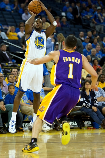 Oct 30, 2013; Oakland, CA, USA; Golden State Warriors point guard Toney Douglas (0) shoots the ball against Los Angeles Lakers point guard Jordan Farmar (1) during the fourth quarter at Oracle Arena. The Golden State Warriors defeated the Los Angeles Lakers 125-94. Mandatory Credit: Kelley L Cox-USA TODAY Sports