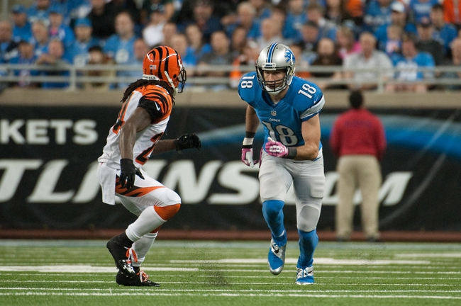 Oct 20, 2013; Detroit, MI, USA; Detroit Lions wide receiver Kris Durham (18) and Cincinnati Bengals cornerback Adam Jones (24) during the fourth quarter at Ford Field. Bengals won 27-24. Mandatory Credit: Tim Fuller-USA TODAY Sports