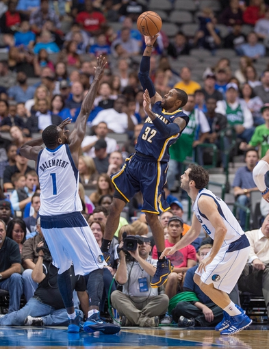 Oct 25, 2013; Dallas, TX, USA; Indiana Pacers point guard C.J. Watson (32) shoots the ball over Dallas Mavericks center Samuel Dalembert (1) during the game at the American Airlines Center. The Pacers defeated the Mavericks 98-77. Mandatory Credit: Jerome Miron-USA TODAY Sports
