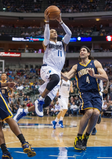 Oct 25, 2013; Dallas, TX, USA; Dallas Mavericks point guard Monta Ellis (11) drives to the basket past Indiana Pacers power forward Luis Scola (4) during the game at the American Airlines Center. The Pacers defeated the Mavericks 98-77. Mandatory Credit: Jerome Miron-USA TODAY Sports