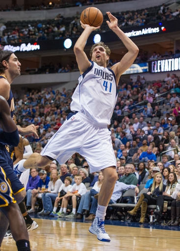 Oct 25, 2013; Dallas, TX, USA; Dallas Mavericks power forward Dirk Nowitzki (41) makes a jump shot during the game against the Indiana Pacers at the American Airlines Center. The Pacers defeated the Mavericks 98-77. Mandatory Credit: Jerome Miron-USA TODAY Sports