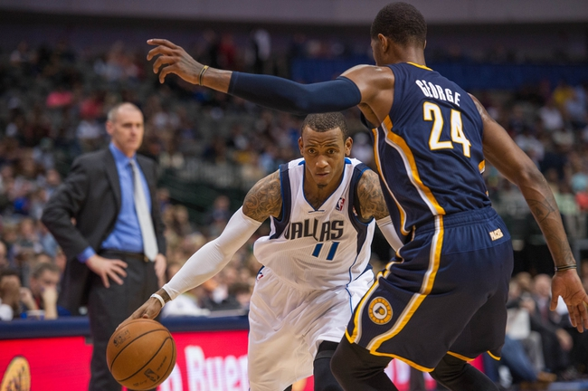 Oct 25, 2013; Dallas, TX, USA; Indiana Pacers shooting guard Paul George (24) guards Dallas Mavericks point guard Monta Ellis (11) during the game at the American Airlines Center. The Pacers defeated the Mavericks 98-77. Mandatory Credit: Jerome Miron-USA TODAY Sports