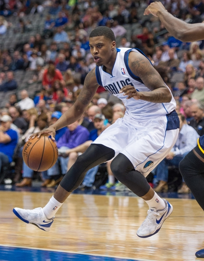 Oct 25, 2013; Dallas, TX, USA; Dallas Mavericks shooting guard Ricky Ledo (7) handles the ball during the game against the Indiana Pacers at the American Airlines Center. The Pacers defeated the Mavericks 98-77. Mandatory Credit: Jerome Miron-USA TODAY Sports