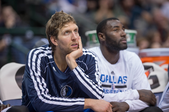 Oct 25, 2013; Dallas, TX, USA; Dallas Mavericks power forward Dirk Nowitzki (41) and center DeJuan Blair (45) watch the Mavericks take on the Indiana Pacers during the game at the American Airlines Center. The Pacers defeated the Mavericks 98-77. Mandatory Credit: Jerome Miron-USA TODAY Sports