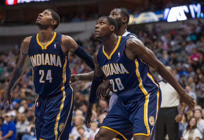 Oct 25, 2013; Dallas, TX, USA; Indiana Pacers shooting guard Paul George (24) and center Ian Mahinmi (28) during the game against the Dallas Mavericks at the American Airlines Center. The Pacers defeated the Mavericks 98-77. Mandatory Credit: Jerome Miron-USA TODAY Sports