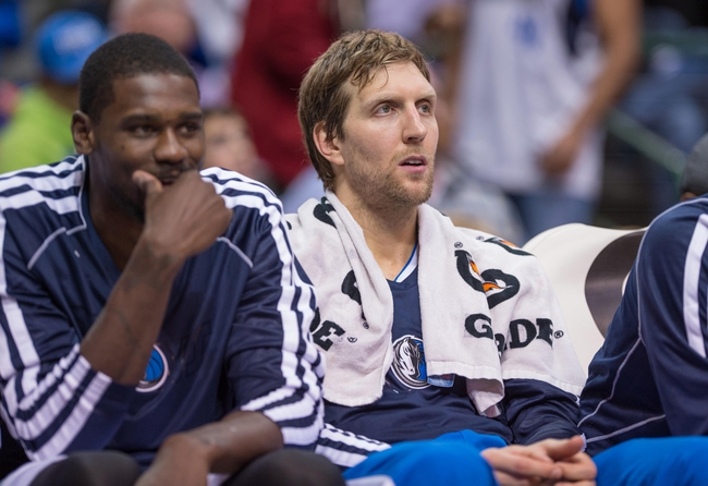 Oct 25, 2013; Dallas, TX, USA; Dallas Mavericks power forward Dirk Nowitzki (41) watches the Mavericks take on the Indiana Pacers during the game at the American Airlines Center. The Pacers defeated the Mavericks 98-77. Mandatory Credit: Jerome Miron-USA TODAY Sports
