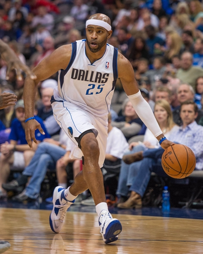 Oct 25, 2013; Dallas, TX, USA; Dallas Mavericks shooting guard Vince Carter (25) brings the ball up court during the game against the Indiana Pacers at the American Airlines Center. The Pacers defeated the Mavericks 98-77. Mandatory Credit: Jerome Miron-USA TODAY Sports