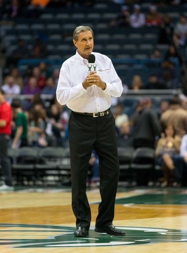 Oct 25, 2013; Milwaukee, WI, USA;  Milwaukee Bucks television announcer Jon McGlocklin speaks to the crowd during the game against the Toronto Raptors at BMO Harris Bradley Center. Mandatory Credit: Jeff Hanisch-USA TODAY Sports