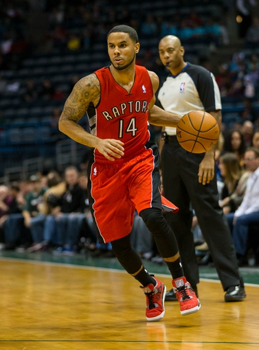 Oct 25, 2013; Milwaukee, WI, USA;  Toronto Raptors guard D.J. Augustin (14) during the game against the Milwaukee Bucks at BMO Harris Bradley Center. Mandatory Credit: Jeff Hanisch-USA TODAY Sports
