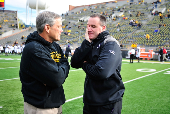 Oct 26, 2013; Iowa City, IA, USA; Iowa Hawkeyes head coach Kirk Ferentz, left, and Northwestern Wildcats head coach Pat Fitzgerald meet prior to game at Kinnick Stadium. Mandatory Credit: Byron Hetzler-USA TODAY Sports