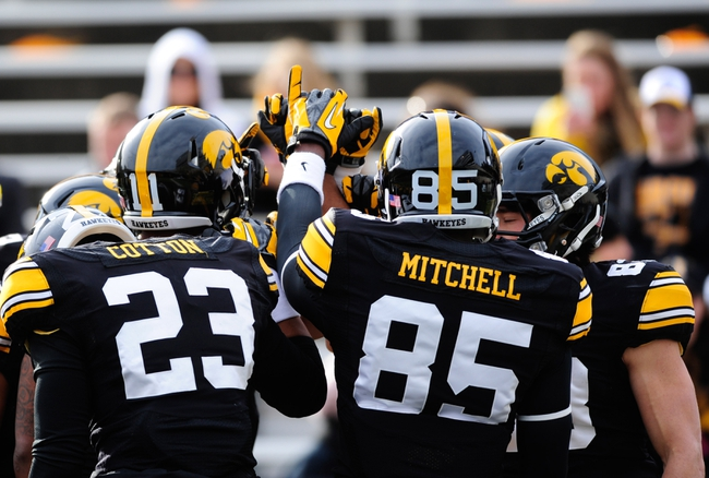 Oct 26, 2013; Iowa City, IA, USA; Iowa Hawkeyes players gather prior to game against the Nothwestern Wildcats at Kinnick Stadium. Mandatory Credit: Byron Hetzler-USA TODAY Sports