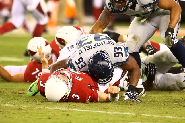 Oct 17, 2013; Phoenix, AZ, USA; Seattle Seahawks linebacker O'Brien Schofield (93) tackles Arizona Cardinals quarterback Carson Palmer (3) at University of Phoenix Stadium. Mandatory Credit: Mark J. Rebilas-USA TODAY Sports