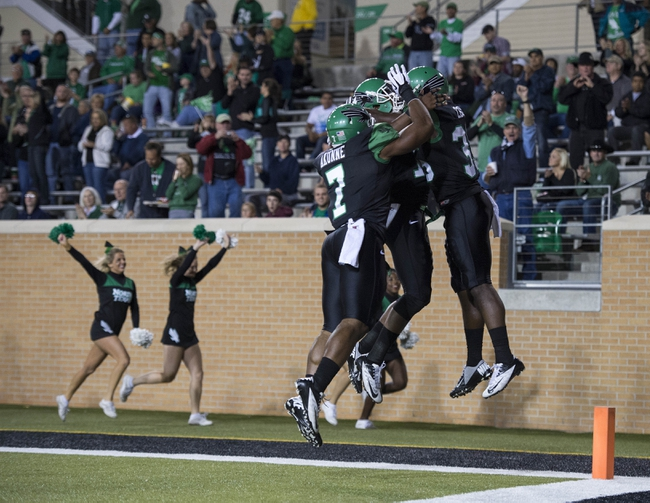 Oct 31, 2013; Denton, TX, USA; North Texas Mean Green linebacker Zach Orr (35) and linebacker Derek Akunne (7) celebrate Orr's touchdown against the Rice Owls during the first half at Apogee Stadium. Mandatory Credit: Jerome Miron-USA TODAY Sports