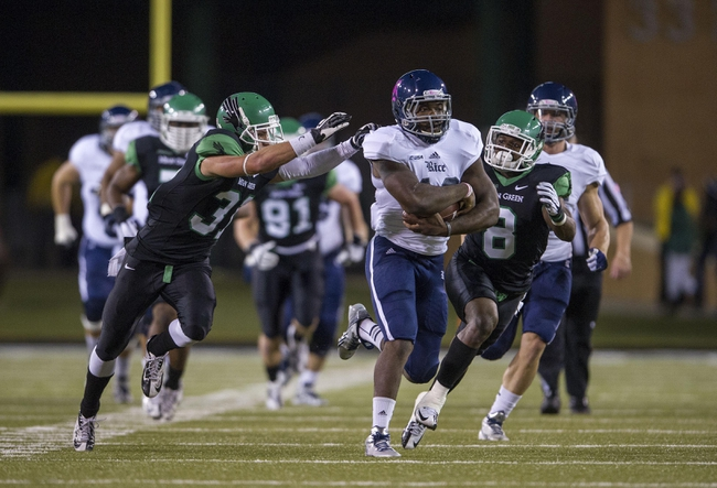Oct 31, 2013; Denton, TX, USA; Rice Owls running back Charles Ross (12) eludes North Texas Mean Green defensive back Kenny Buyers (31) and defensive back Marcus Trice (8) during the first half at Apogee Stadium. Mandatory Credit: Jerome Miron-USA TODAY Sports