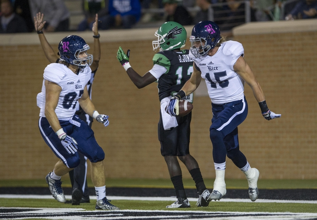 Oct 31, 2013; Denton, TX, USA; Rice Owls wide receiver Jordan Taylor (15) and tight end Connor Cella (87) celebrate the  touchdown against the Rice Owls during the first half at Apogee Stadium. Mandatory Credit: Jerome Miron-USA TODAY Sports
