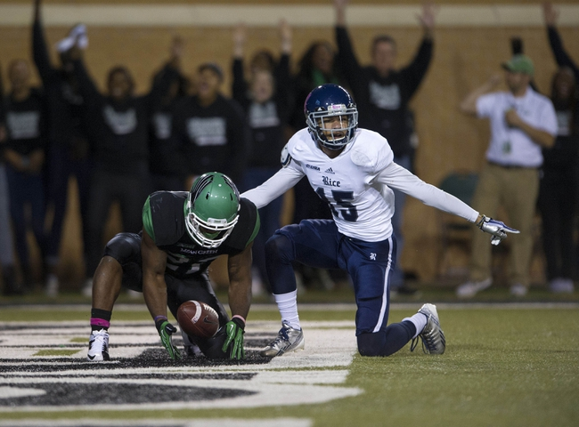 Oct 31, 2013; Denton, TX, USA; North Texas Mean Green running back Antoinne Jimmerson (22) scores a touchdown against Rice Owls cornerback Phillip Gaines (15) during the first half at Apogee Stadium. Mandatory Credit: Jerome Miron-USA TODAY Sports