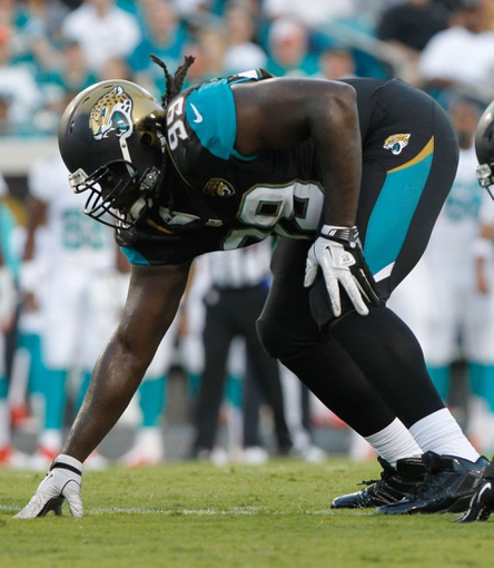 Aug 9, 2013; Jacksonville, FL, USA; Jacksonville Jaguars defensive tackle Sen'Derrick Marks (99) rushes during the first quarter against the Miami Dolphins at EverBank Field. Mandatory Credit: Kim Klement-USA TODAY Sports