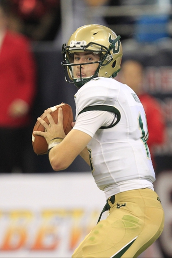 Oct 31, 2013; Houston, TX, USA; South Florida Bulls quarterback Mike White (14) passes against the Houston Cougars during the second half at Reliant Stadium. Houston won 35-23. Mandatory Credit: Thomas Campbell-USA TODAY Sports