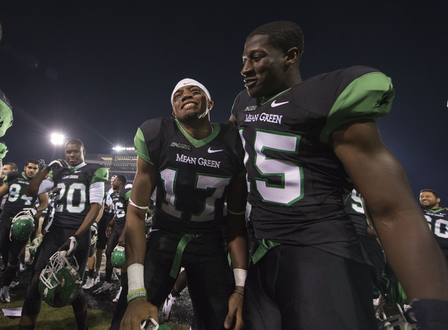 Oct 31, 2013; Denton, TX, USA; North Texas Mean Green wide receiver Lynrick Pleasant (17) and defensive back Mike Marshall (15) celebrate the win over the Rice Owls at Apogee Stadium. The Mean Green defeated the Owls 28-16. Mandatory Credit: Jerome Miron-USA TODAY Sports
