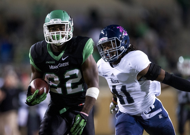 Oct 31, 2013; Denton, TX, USA; North Texas Mean Green running back Antoinne Jimmerson (22) eludes Rice Owls linebacker Alex Lyons (41) and runs for a touchdown during the second half at Apogee Stadium. The Mean Green defeated the Owls 28-16. Mandatory Credit: Jerome Miron-USA TODAY Sports